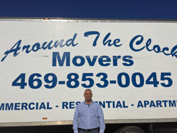 Owner posing in front of Around The Clock Movers truck