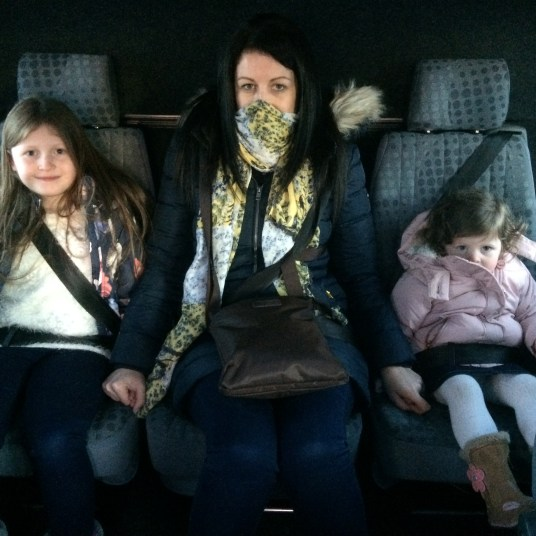 Keeping cosy inside Santa's Airport transfer bus to the Santa Claus Holiday Village in Rovaniemi, Finland