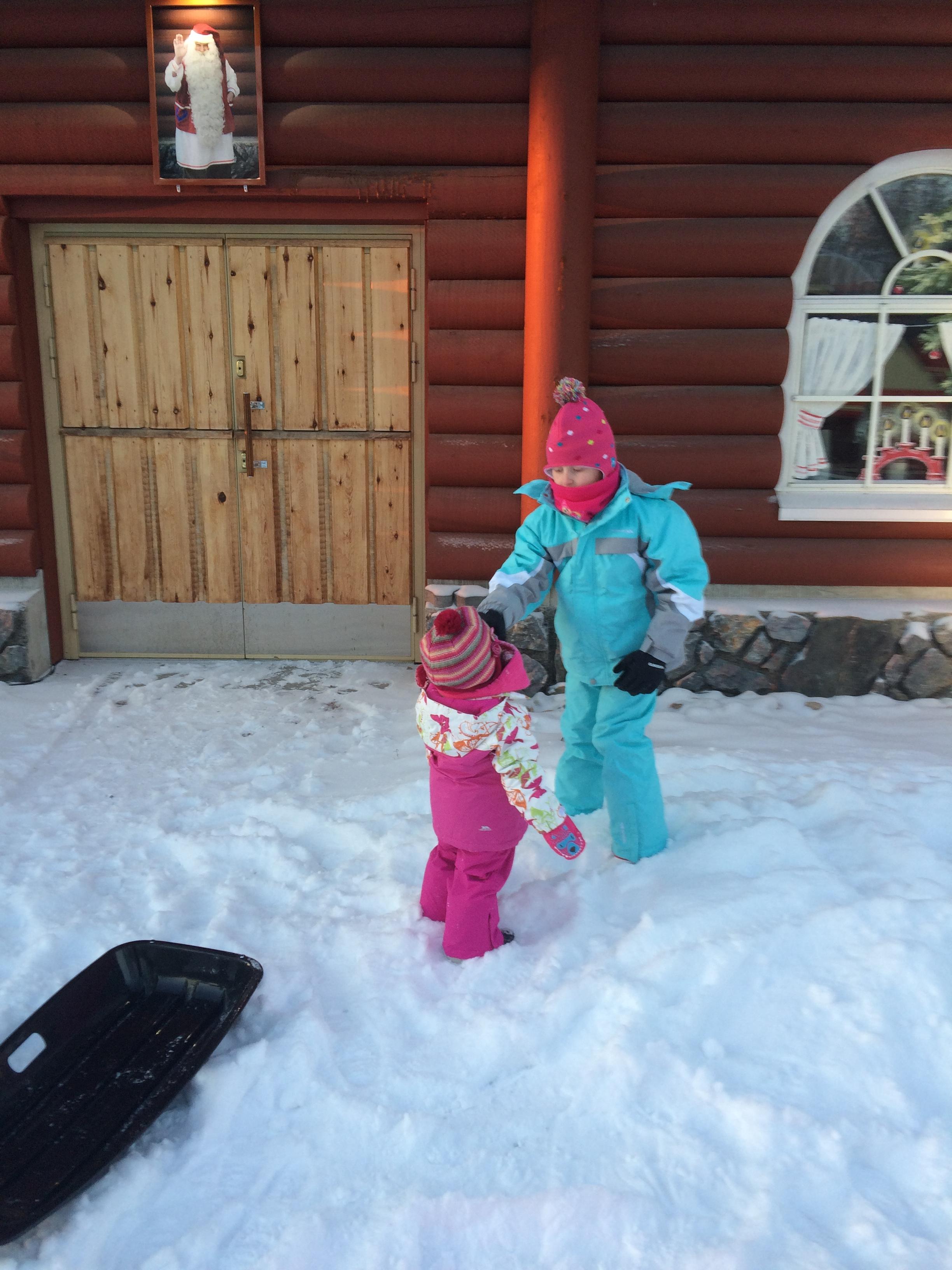 Enjoying the snow at Santa Claus Holiday Village in Rovaniemi, Finland