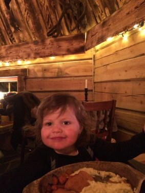 Matilda enjoying her food at the Kotahovi Restaurant in Rovaniemi, Finnish Lapland