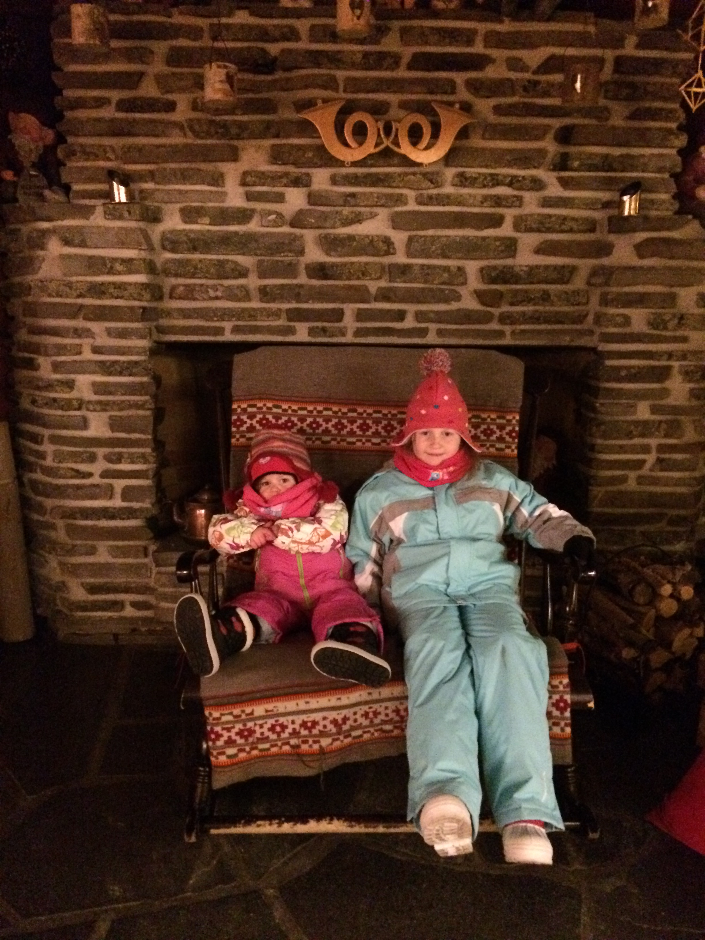Lily-Belle and Matilda take time out on Santa's chair