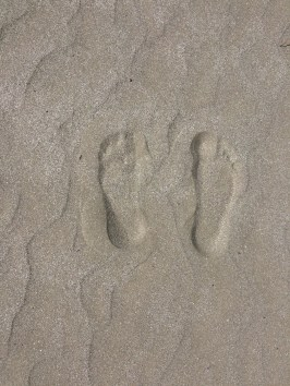 Footprints in the sand on Spiaggia e Mare Holiday Park private beach