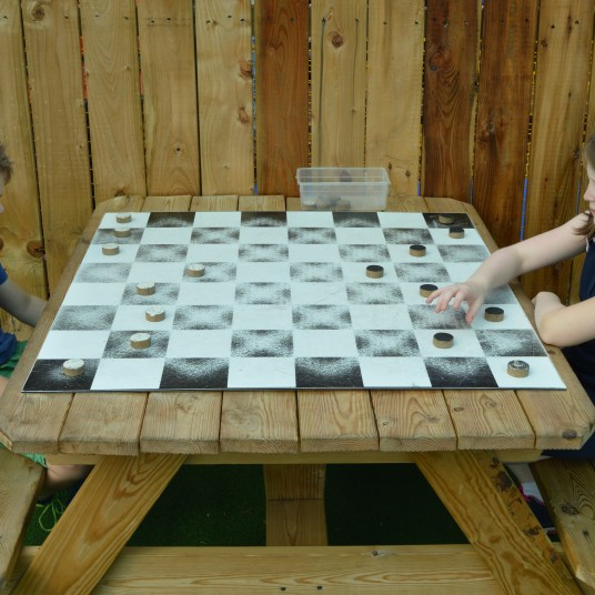 Playing Draughts at the Adventure Play Area at Tropical World in Letterkenny, Ireland