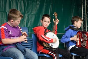 Children from Omagh Comhaltas Ceoltóirí Éireann playing music at Festival Lough Erne