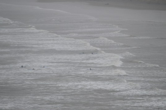 Swimmers braving the elements in the Atlantic Ocean