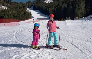 Matilda and Lily-Belle enjoying skiing at Alpe Cermis