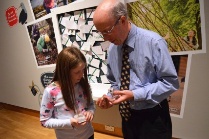 Lily-Belle showing Dr Mike Simms her Ammonites