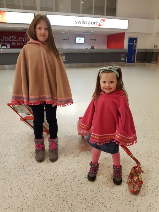 The girls making their waythrough Belfast International Airport
