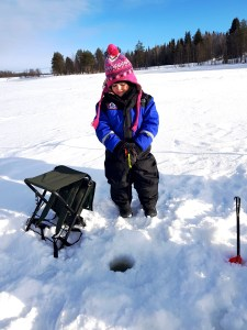 Matilda Ice Fishing at Ruka Lake in Finland