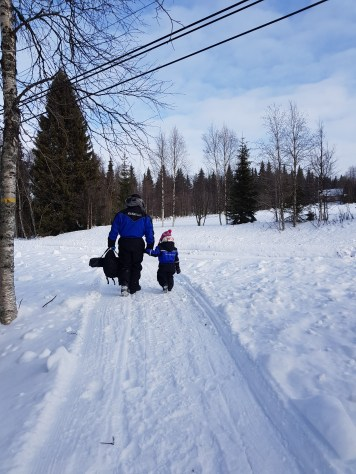 Henri and Matilda going Ice Fishing at Ruka Lake