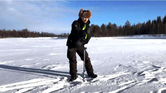 Prepping the ice for fishing at Ruka Lake