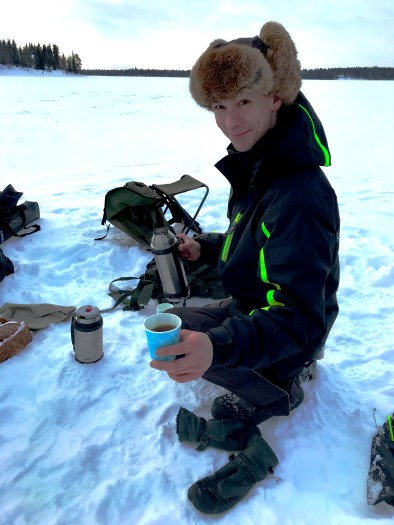 Henri serving up coffee Ice Fishing in Ruka