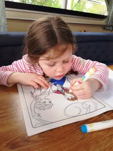 Matilda colouring her book on board the Crusader