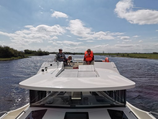 Steering from the top deck of the Horizon 4 on the River Shannon cruise with Emerald Star