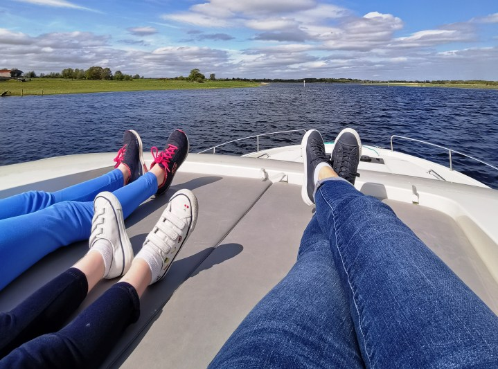 Relaxing on the upper deck of the Horizon 4 provided by Le Boat
