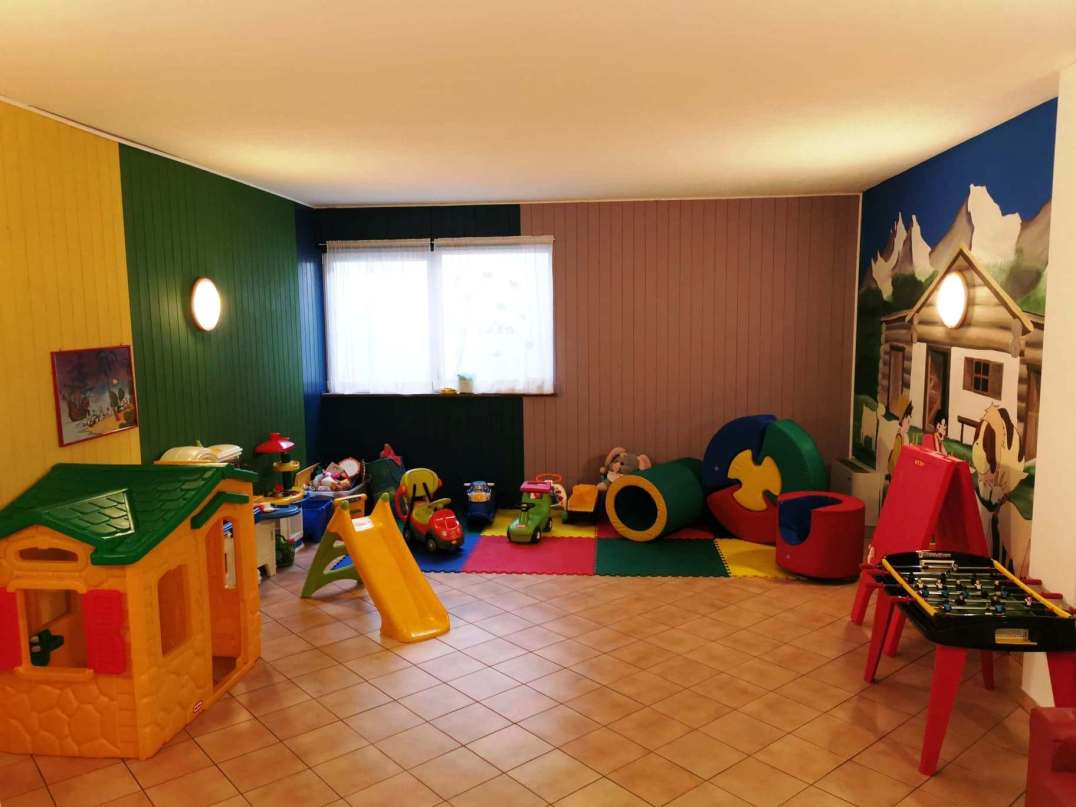 Play and baby Room at Aparthotel Majestic, Pedazzo