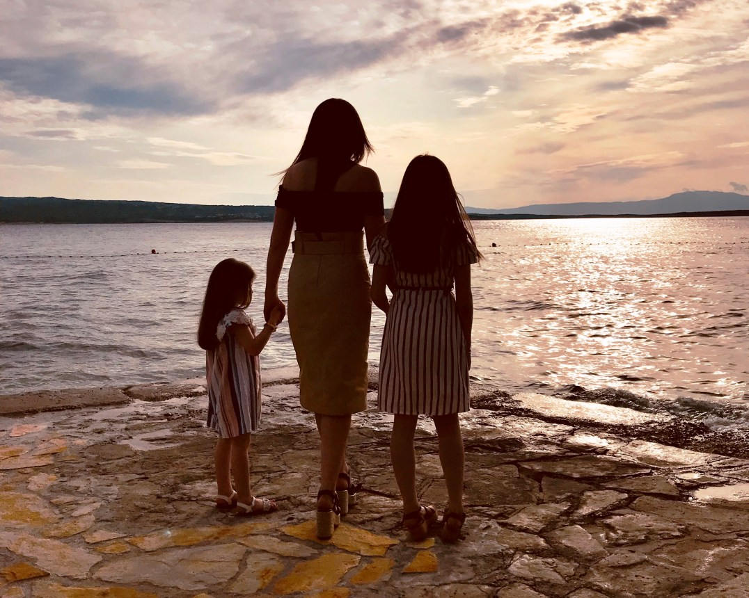 The Callaghan Posse watch a sunset over Punat