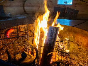 Flickering fire pit at Vaara Reindeer Farm in Finnish Lapland