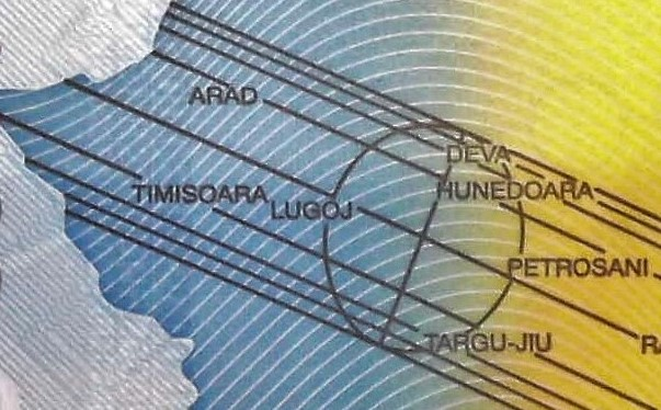 closeup detail from Romania 2000 Lei Banknote back, featuring track of a solar eclipse