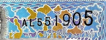 closeup detail from Suriname 5 Guden Banknote, Year 2000 front, featuring artist rendering of forests of Suriname