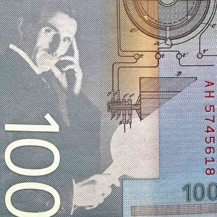 closeup detail of portrait of Nikola Tesla from Serbia 100 Dinara Banknote front