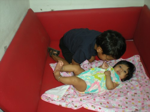 Playing together in one of the mother's rooms
