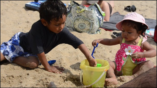 My son instructing my daughter on sand play