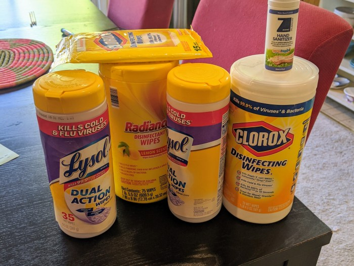 Several bottles and packages of disinfecting wipes and hand sanitizer