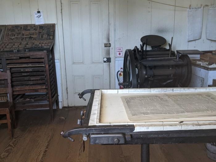 An old printing press and printing blocks