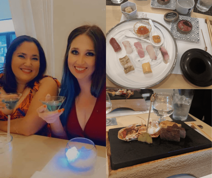 Two women toasting a blue drink, a sushi plate, and a Japanese grilled plate.