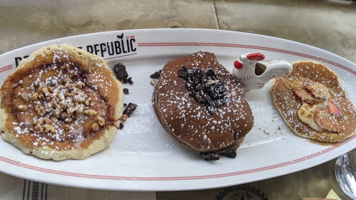 3 pancakes of different flavors on a Breakfast Republic plate