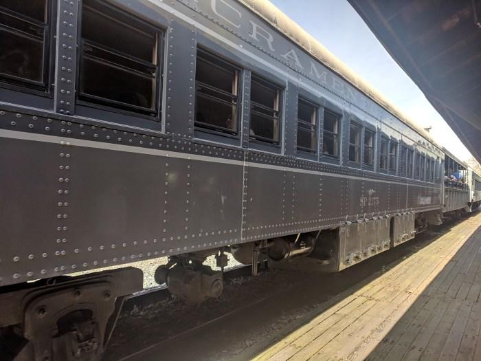 A steam train at the platform