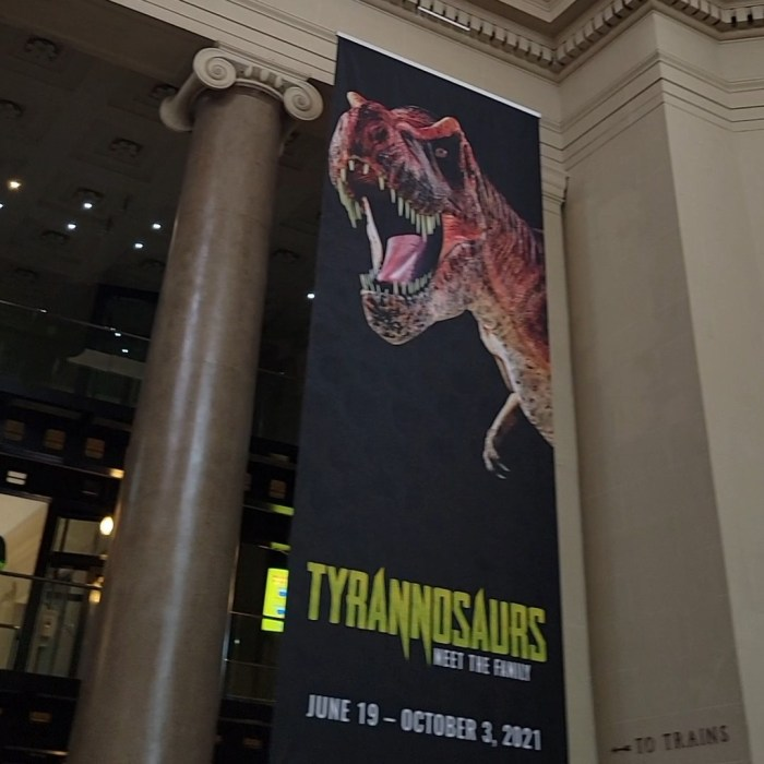 A sign advertising a Tyrannosaurs limited edition exhibit at the Science Museum of Virginia