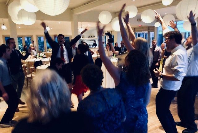 Guests enthusiatically dancing on the dancle floor
