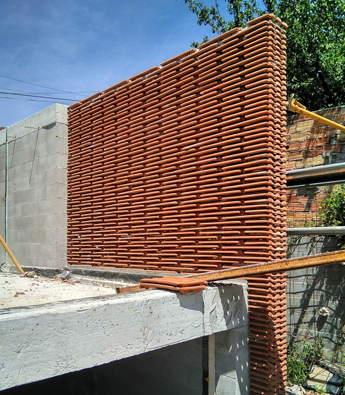 muro-palomero-tejar-celosia-terraza-moana-vigo-teja-apilada-estudio-arquitectura-arquitecto-curras-torres