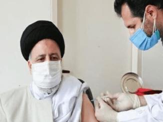Ebrahim Raisi Menerima Vaksin Covid-19 Buatan Lokal