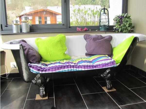 Riciclo oggetti come trasformare una vasca in divano FOTO