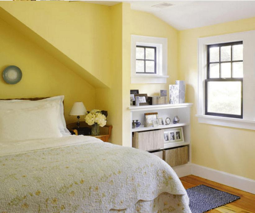 Pareti gialle in camera da letto per un'atmosfera shabby