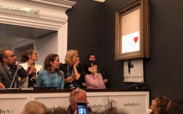 42002647_354645935101791_2064314080121368222_n-698x435 Banksy Painting Shreds Itself After Selling At Sotheby's Random