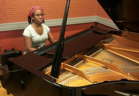 sitting at piano