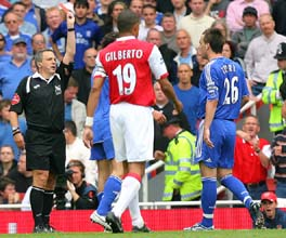 Chelsea's Khalid Boulahrouz is dismissed after chopping down Arsenal's Julio Baptista