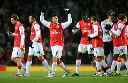 The Arsenal boys celebrate another major step towards the title