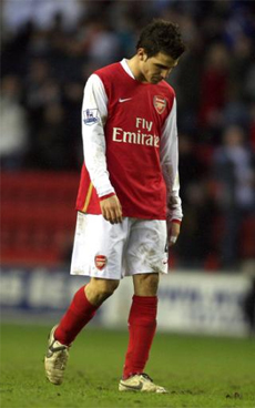 A disappointed Fabregas trudges off after Arsenal's draw with Wigan