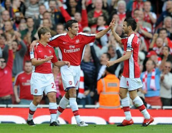 Cesc Fabregas celebrates with van Persie and Arshavin