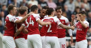 Mesut Ozil reacts to comparisons with Arsenal legend Dennis Bergkamp