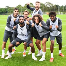 Arsenal players lineup for a picture