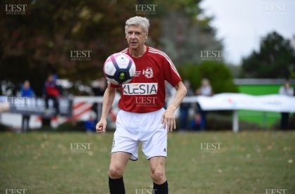 Arsene Wenger with the ball