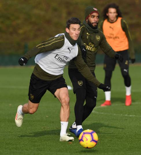 ST ALBANS, ENGLAND - NOVEMBER 21: (L-R) Laurent Koscielny and Alex Lacazette of Arsenal during a training session at London Colney on November 21, 2018 in St Albans, England. (Photo by Stuart MacFarlane/Arsenal FC via Getty Images) *** Local Caption *** Laurent Koscielny;Alex Lacazette