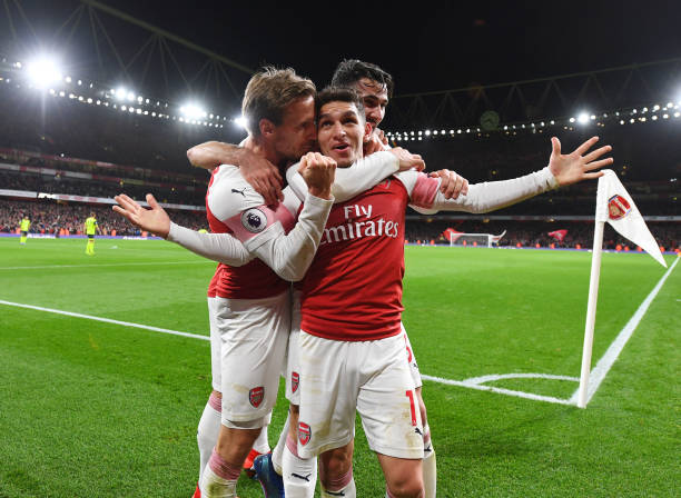 Lucas-torreira-celebrates-his-goal-with-nacho-monreal-and-sead-the-picture-id1069831638