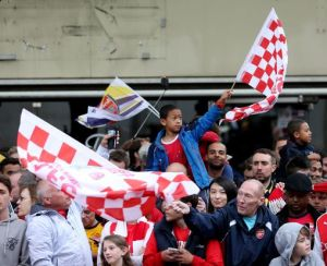 Fans of all ages and races join Arsenal FA Cup winning celebrations